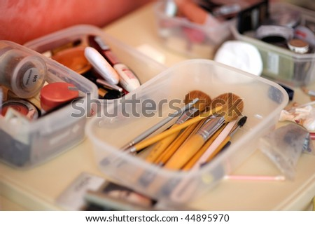 Some makeup brushes in a plastic box