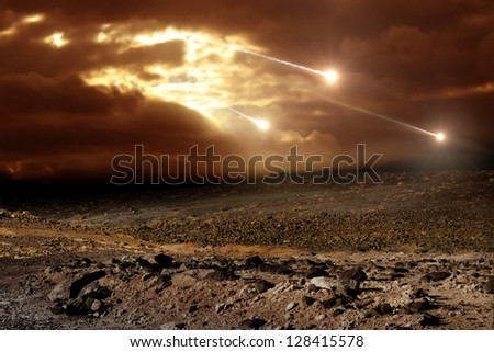 Some meteors rain from the sky through clouds - stock photo