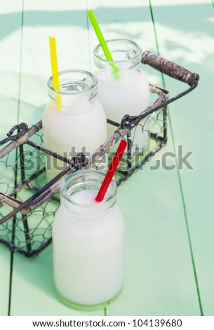 Some milky drinks in a tray for lunch time outdoors - stock photo
