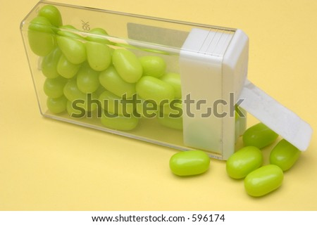 Some mints spilling from an opened container - stock photo