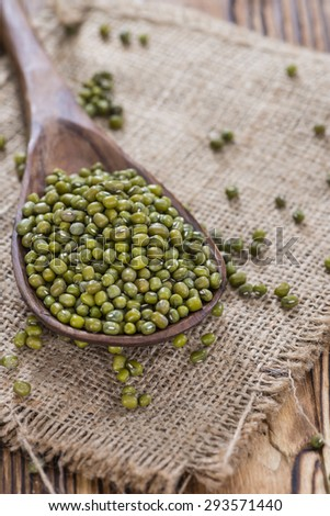 Some Mung Beans on an old wooden table (close-up shot)