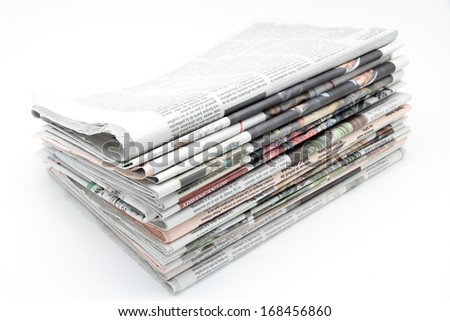 some newspapers on white background - stock photo