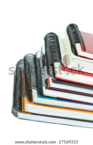 Some notebooks with soft shadow on white background. Shallow depth of field - stock photo