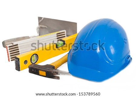 some objects from the construction industry - construction concept with hard hat working tools - stock photo