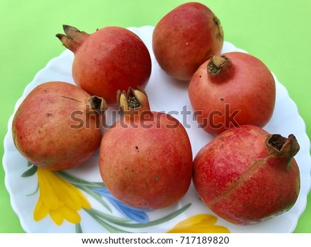 Some of red coloured ripe pomegranates. It's a very tasty and healthy fruit.
