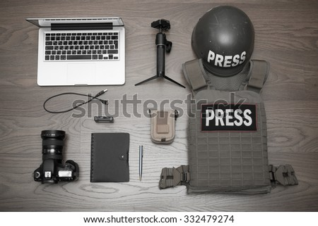 Some of the equipment necessary for the work of the photographer in the conflict zone - stock photo