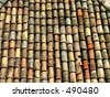 Some of the few remaining original tiles on the roofs of the old city of Dubrovnik. - stock photo