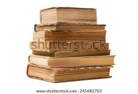some old books stacked on a white background