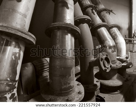 some old pipes in brown toned ambiance - stock photo