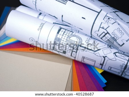 some paint samples with plans of building - stock photo