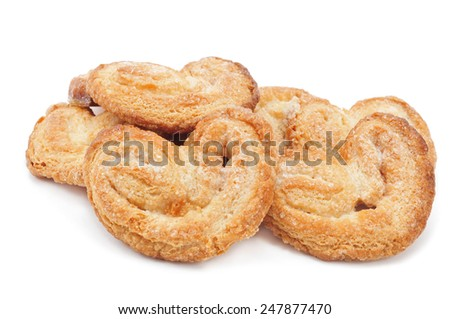 some palmeras, spanish palmier pastries, on a white background - stock photo