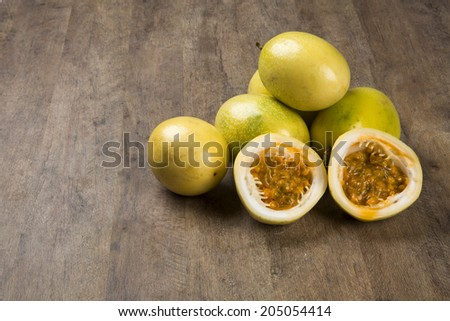 Some passion fruits over a wooden table - stock photo