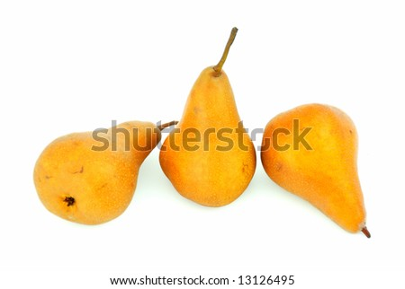 Some pears with freckles isolated on white background. - stock photo