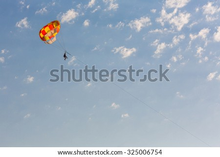 Some people parasailing over the sea