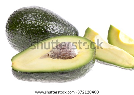 some pieces of avocado isolated on white background. - stock photo
