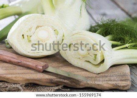 Some pieces of fresh Fennel on wood