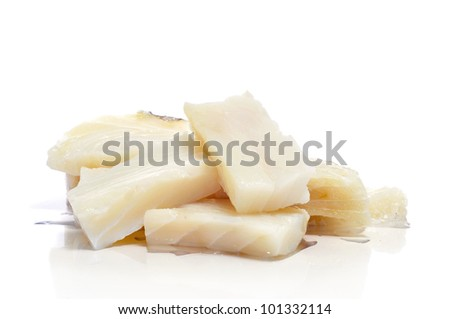 some pieces of raw cod on a white background - stock photo
