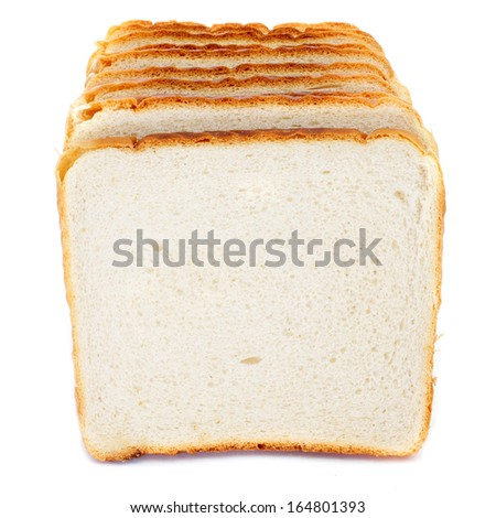 some pieces of sliced bread on a white background