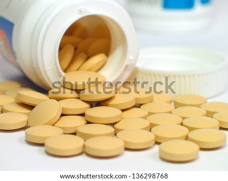 Some pills on white background