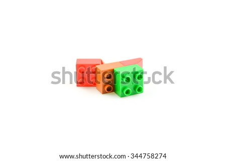 Some plastick bricks from game isolated on the white - stock photo