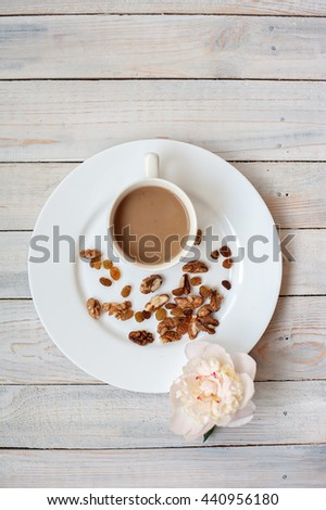 some raisins and nuts in a light dish - stock photo
