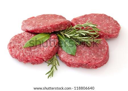 some raw hamburgers isolated on white background - stock photo