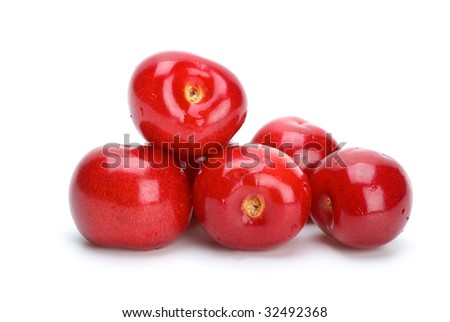 Some red ripe cherries isolated on the white background