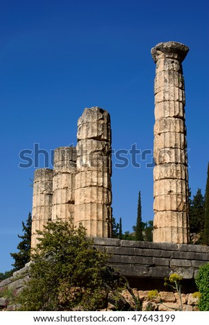 Some remaining  columns of an ancient greek temple in Delphi. Nice shot against deep blue sky.