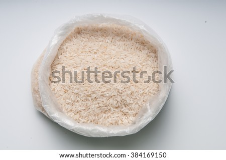 Some rice in a sack - stock photo