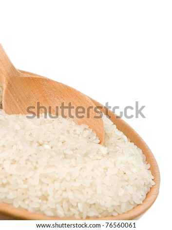 some rice in wooden plate and spoon isolated on white background - stock photo