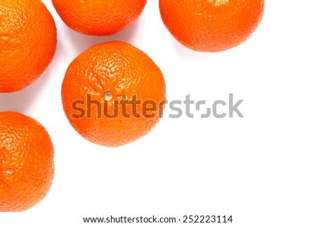 Some ripe big mandarin on white - stock photo
