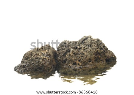 "Some  rocks on white sitting in the water ""like a rock"" to portray strength and stability"