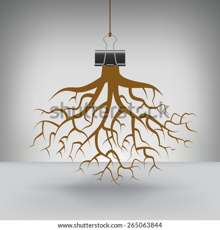 Some Roots Hung by a Binder Clip - stock photo