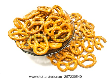 some salted pretzels on white background closeup