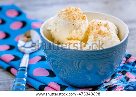 Some scoups of homemade coconut ice cream in a bowl. Selective focus