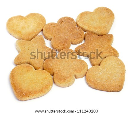 some shortbread biscuits with different shapes on a white background - stock photo