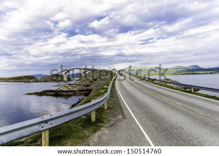 Some shots with traffic on a curved coast bridge in Norway. - stock photo
