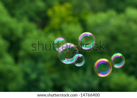 Some soap bubbles on green blurred background - stock photo