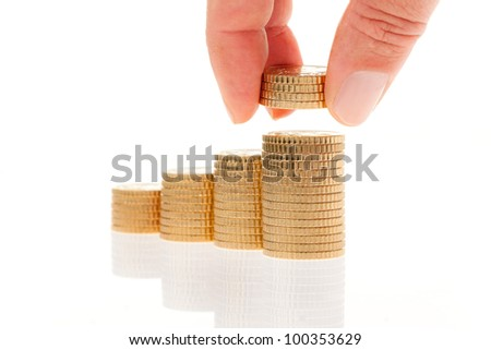 some stacks of coins on white background