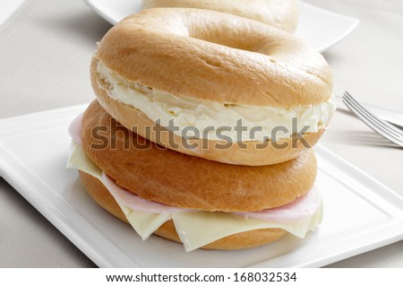 some stuffed bagels in a plate on a set table