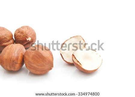 some tasty hazelnuts on white background closeup - stock photo