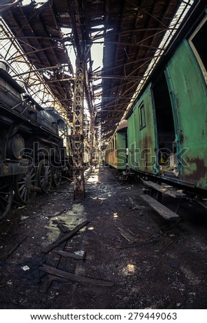 Some trains at abandoned train depot