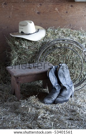 Some typical cowboy gear on a ranch. - stock photo