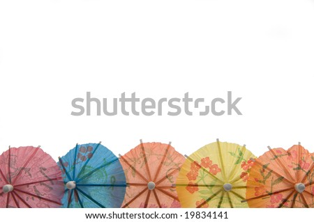 Some variegated umbrellas for juice and martini