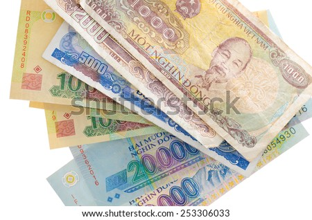 some Vietnam paper banknotes over white background