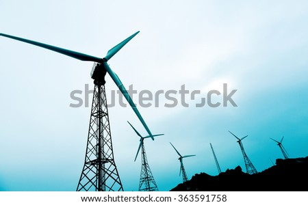 some wind turbines in a wind farm, in a cloudy day - stock photo