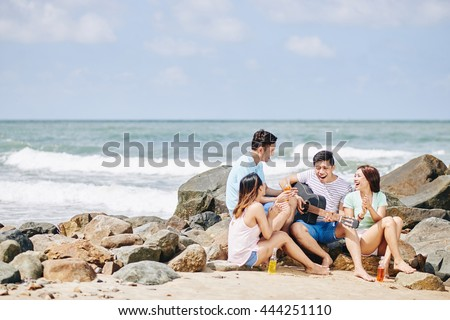 Somebody taking photo of friends jumping at the beach - stock photo
