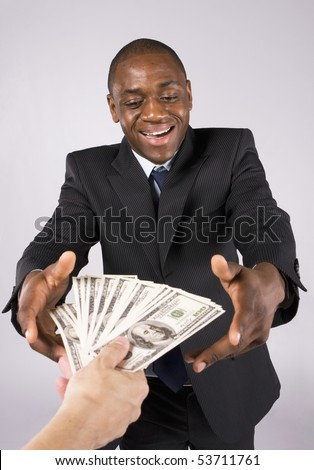 Someone giving many banknotes to an african business man
