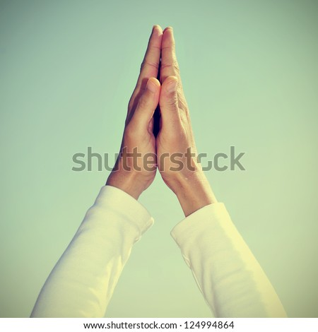 someone meditating with his hands in prayer mudra - stock photo
