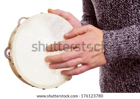 someone playing a tambourine over a white background - stock photo